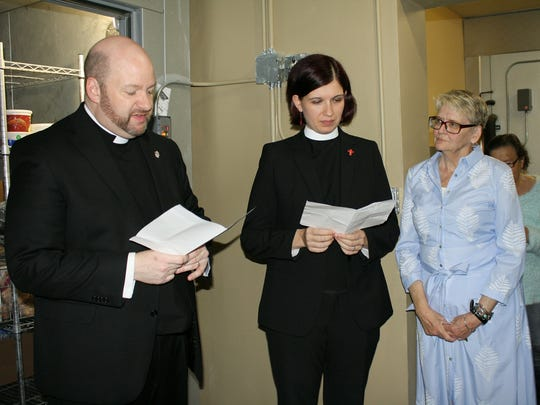 The Rev. Dean Patrick Perkins and the Rev. Canon Ezgi Saribay Perkins speak during the dedication of the new walk-in freezer. Lucy Sumner, director of Broken Bread, is also pictured.