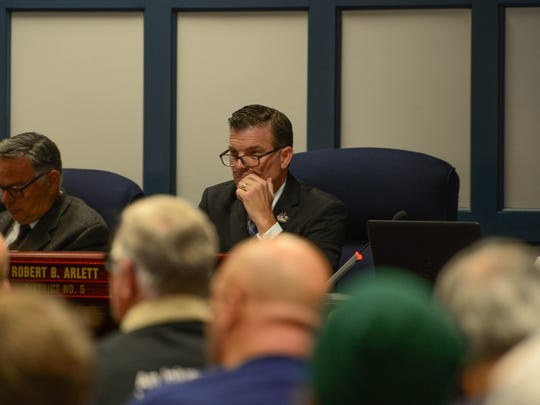 """County Council member Robert Arlett, listens to members of the community as they voice their options on Tuesday, Oct. 31, 2017 at the Sussex County Court House in Georgetown during public comment in response to a possible introduction of a proposed ordinance """"Right-to-Work."""""""