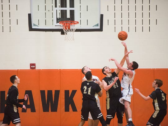 Delone's Bryce Mondorff blocks a shot by Hanover's Will McQueen on Wednesday Jan. 20, 2016 at Hanover High School.