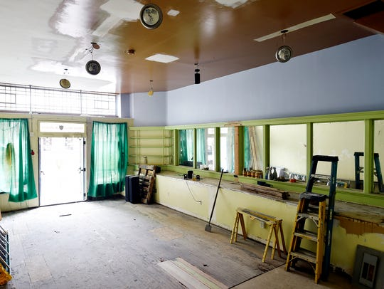 A dining area, still under renovation, is shown in