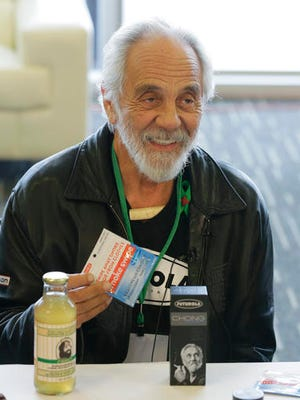 """FILE - In this Feb. 19, 2015 file photo, comedian and marijuana icon Tommy Chong, talks about his line of marijuana products, including his """"Chongwater"""" hemp drink, a custom joint roller, and his """"Smoke Swipe"""" wipes that can remove the odor of pot smoke from clothing, during CannaCon, a marijuana business trade show in Seattle. Chong tweeted Thursday, Feb. 23, 2017, """"Don't worry stay High"""" in response to a potential crackdown on recreational pot use by the Trump administration."""