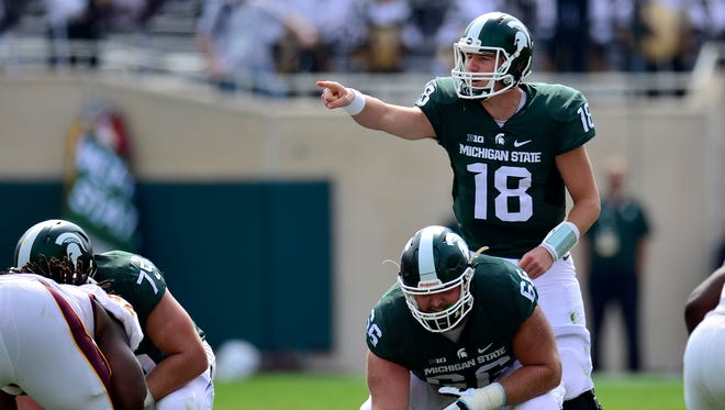 Mel Kiper ranks Connor Cook the No. 4 quarterback and Jack Allen the No. 5 center.