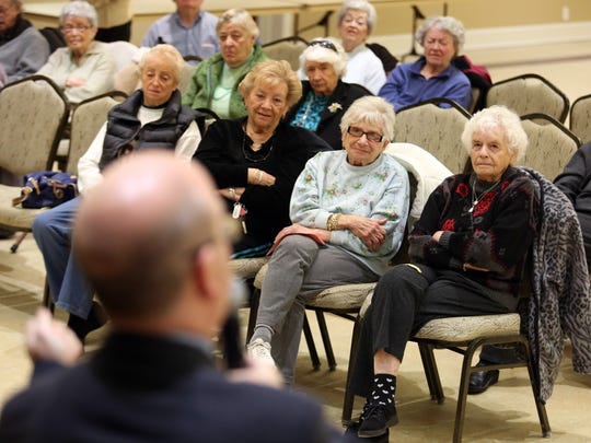 David P. Willis talks with members of the Hadassah Club at Leisure Village West in Manchester. He warns: If someone call you out of the blue and asks you for money, hang up the telephone.