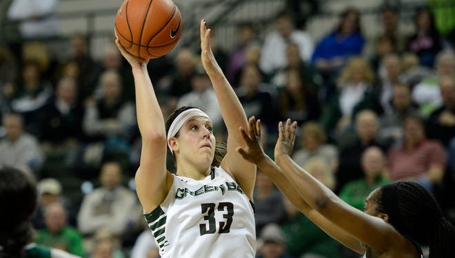 UW-Green Bay's Lexi Weitzer (33) takes a shot over Cleveland State's Kiersten Green (21) in the first half during Saturday's Horizon League game at the Kress Events Center in Green Bay. Evan Siegle/Press-Gazette Media