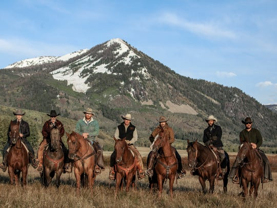 """This image released by Paramount Network shows, from left, Wes Bentley, Forrie Smith, Luke Peckinpah, Kevin Costner, Dave Annable, Denim Richards and Cole Hauser from the series """"Yellowstone,"""" premiering Wednesday, June 20."""