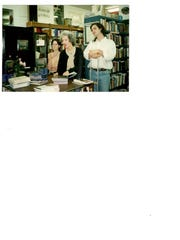 Phyllis Tickle at Burke's Book Store with two of her children, Rebecca and Sam Jr.