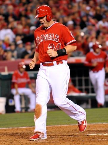 Angels designated hitter C.J. Cron crosses home plate
