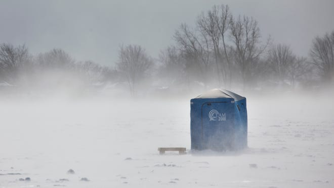 A shanty is whipped by blowing wind and snow during a kidsÕ ice fishing derby Saturday, Feb. 14, 2015 on Lake St. ClairÕs Bouvier Bay.