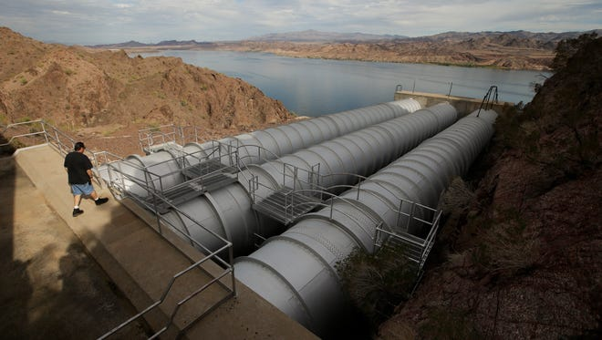 In this Thursday, Oct. 15, 2015 photo, mechanic John Harper walks onto the pipes conveying water pumped from the Colorado River at the Metropolitan Water District of Southern California's Whitsett Intake Pumping Plant near Parker Dam, Calif. The pumping plant is the starting point of the Colorado River Aqueduct. (AP Photo/Jae C. Hong)