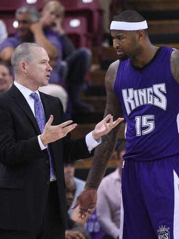 Michael Malone, now fired, coaches Kings center DeMarcus