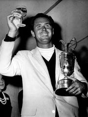 Tony Lema of San Leandro, California, holds a glass of champagne and his trophy after winning the British Open Golf Championship at St. Andrews, Scotland on July 10, 1964. The 30-year-old Lema carded 279 for the 72 holes.
