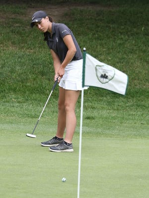 Grace May watches her putt on hole 18 at Skyland Pines.