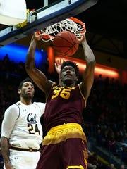 ASU forward De'Quon Lake dunks against Cal forward Marcus Lee in Saturday's Sun Devils win.