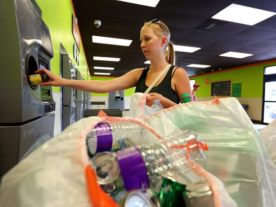 Emily Rueda cashes in her deposit bottles at the BottleDrop Oregon Redemption Center on Commercial Street SE in 2015.