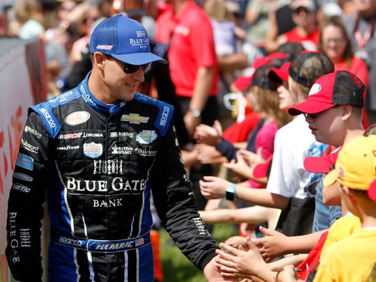 FILE - In this Aug. 12, 2017, file photo, Daniel Hemric greets fans during drivers introductions for the NASCAR Xfinity Series auto race at Mid Ohio Sports Car Course in Lexington, Ohio. In the Xfinity Series, the title is between three drivers from JR Motorsports and Daniel Hemric. It's an-all Chevrolet championship bout. Representing JR Motorsports in Saturday's race are Justin Allgaier, William Byron and Elliott Sadler. (AP Photo/Tom E. Puskar, File)