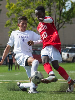 Tech's David Garcia (left) attempts to steal the ball Saturday from South's Jama Warsame.