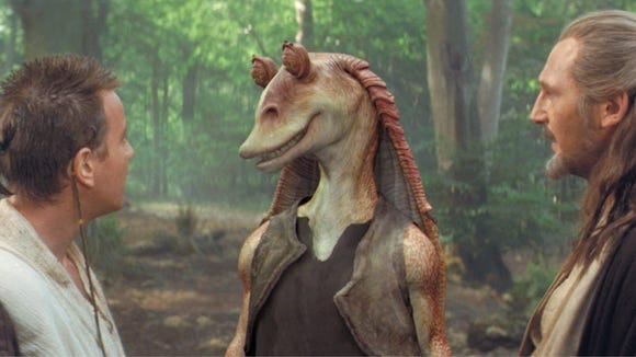 Jar Jar Binks (center) chats with/annoys Obi-Wan and