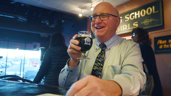 Pastor Tim Worthington drinks a beer at Monks House