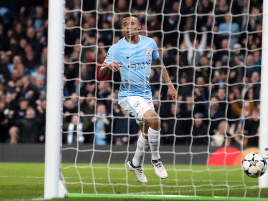Manchester City's Gabriel Jesus scores his side's first goal of the game during the Champions League, round of 16, second leg soccer match between Manchester City and Basel at the Etihad Stadium in Manchester, England, Wednesday, March 7, 2018. (Martin Rickett/PA via AP)