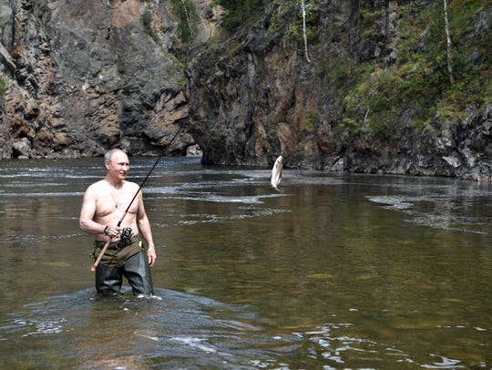 Russian President Vladimir Putin fishes in the remote