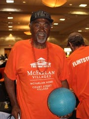 Roosevelt Mitchner of the McFarland Villages community with a basketball, waiting to compete in the Hoop Shoot at the Victory Cup on June 22, 2018.