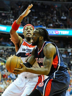 Atlanta Hawks forward DeMarre Carroll (5) handles the ball as Washington Wizards forward Paul Pierce (34) defends during the first half in Game 6 of the second round of the NBA Playoffs at Verizon Center.