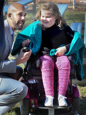 Boston Red Sox pitcher David Price, left, talks with Carlee Beam, 8, before the two break ground for the Miracle Fields ball park, Thursday, Feb. 4, 2016, at McKnight Park. The ball park will allow children with both physical and metal disabilities to play ball.