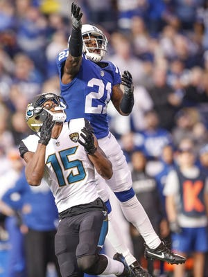 Indianapolis Colts cornerback Vontae Davis (21) breaks up a pass intended for Jacksonville Jaguars wide receiver Allen Robinson (15) in the first half at Lucas Oil Stadium on Jan. 1, 2017.