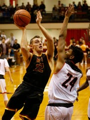 Kelden Tyson of McCutcheon with a shot over Ziare Williams of Lafayette Jeff the sectional semifinal Friday, March 2, 2018, in Lafayette. McCutcheon defeated Jeff 67-53.