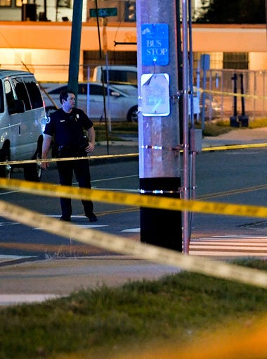Metro Nashville Police officers work the scene of a shooting near Jo Johnston and 17th Avenue North Thursday, July 26, 2018, in Nashville, Tenn.