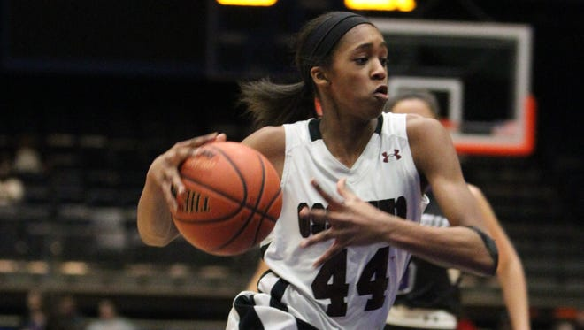 Ossining's Aubrey Griffin drives to the net during a Section 1 Class AA girls basketball semifinal with New Rochelle at the Westchester County Center Feb. 25, 2016.