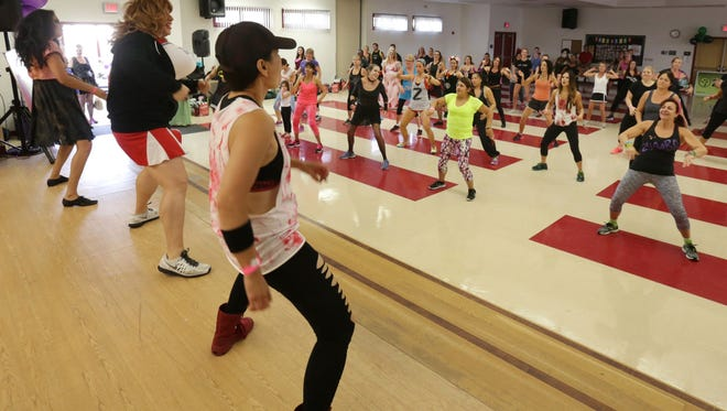Dancers participate in a Fit 4 the Cause Zumbathon in 2015.