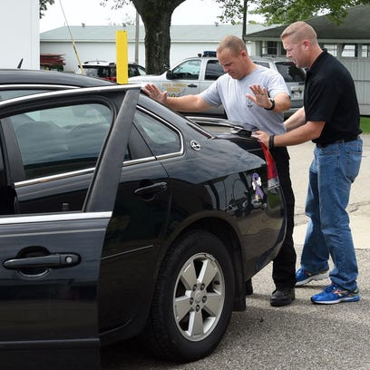 Chillicothe Police Officer Matthew Shipley, right,