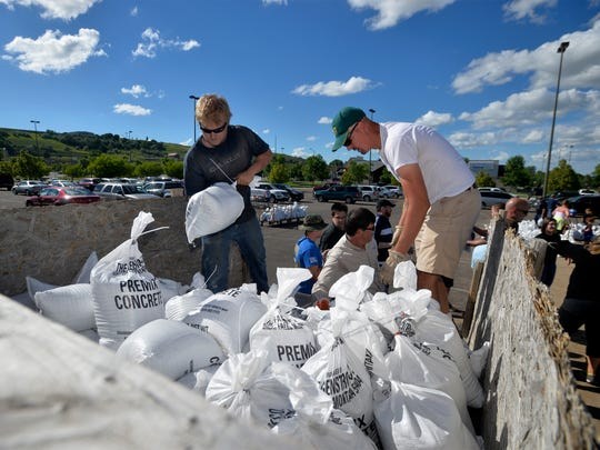 Volunteers load a truck with sandbags in the parking lot of Home Depot on Wednesday evening.  On Wednesday the Weather Service in Great Falls issued a flood warning on the Missouri River in Great Falls for noon on Thursday.