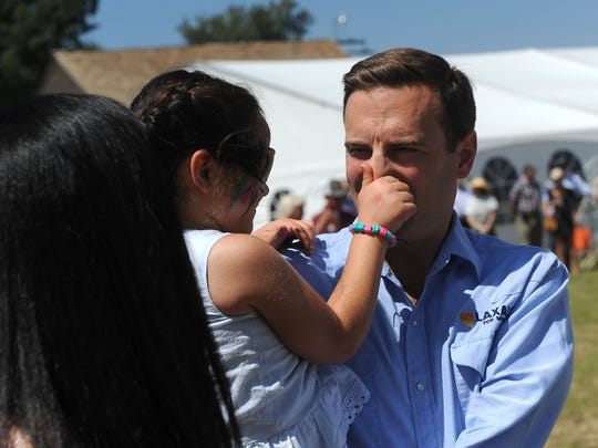 Nevada Attorney General Adam Laxalt gets his nose grabbed by his daughter Sophia during the 4th annual Basque Fry at the Corley Ranch in Gardnerville, Nev. on Aug. 25, 2018.