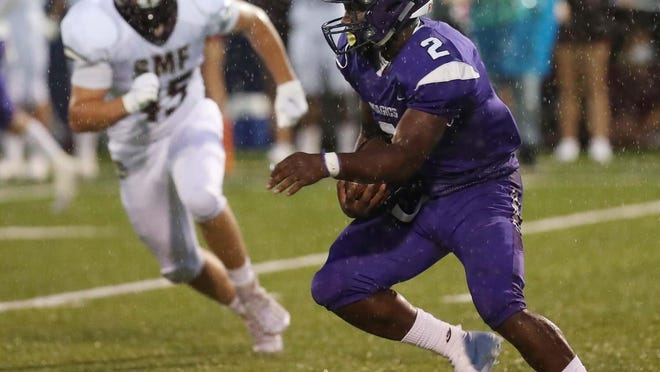 Barberton running back Cam Macon runs with the ball under pressure from Stow's Kaden Spiegel during their game at Barberton High School Friday, Aug. 28, 2020 in Barberton, Ohio.