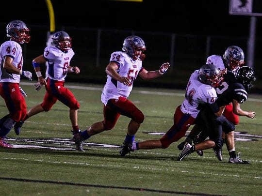 The Patriot defense swarms to stop a North Buncombe ball carrier.