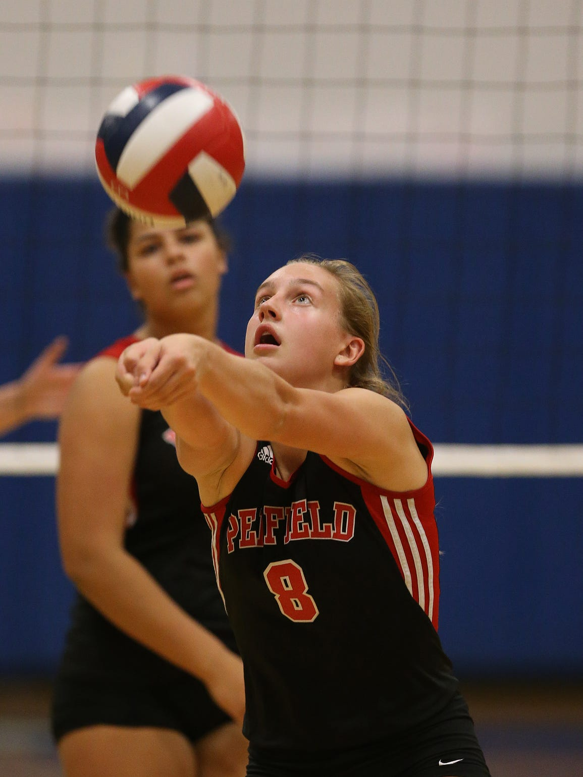 Penfield's Alea Steigerwald sets the ball against Victor