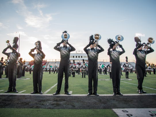 The Mason High School Marching Comets unveil new uniforms