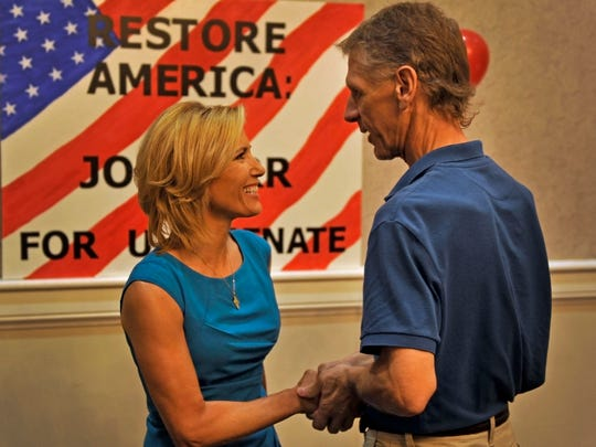 Laura Ingraham shakes hands with Glen Wilson during a rally for Joe Carr at Millennium Maxwell House Hotel in Nashville on Tuesday, July 22, 2014.