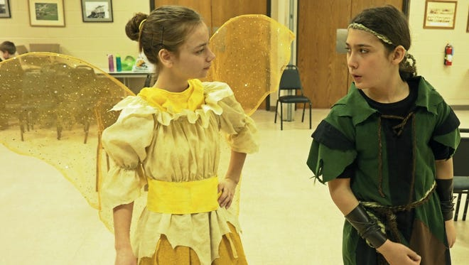 """Tinkerbell, portrayed by Sarah Doll, argues with Peter Pan, played by John Schauer. The  Fond du Lac Area Homeschool Drama Troupe will present """"Peter Pan"""" on March 18 and 19."""