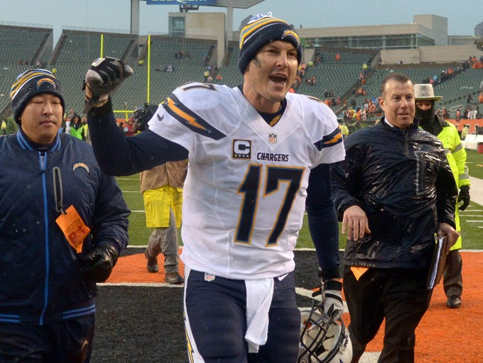 San Diego Chargers quarterback Philip Rivers celebrates after winning the wild-card playoff game against the Cincinnati Bengals, 27-10.