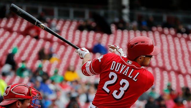 Cincinnati Reds left fielder Adam Duvall (23) singles in the fourth inning.