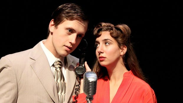 "Daniel Taddy, left, plays George Bailey and Emily Ahrens plays Mary Bailey in the University of Wisconsin-Green Bay production of ""It's A Wonderful Life: A Live Radio Play"" this week."