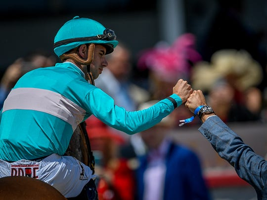 Jockey Florent Geroux, is congratulated after winning race seven on Derby Day at Churchill Downs in Louisville, Ky, Friday, May 5, 2016.  Bryan Woolston / Special to the Courier Journal