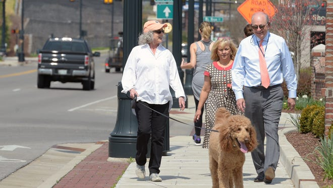 Franklin Mayor Ken Moore walks with Kristy Williams and Rudy Jordan during the Walk with the Mayor event in downtown Franklin on March 29, 2017.