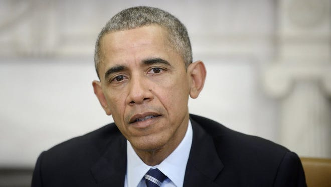 President Obama makes a statement on the San Bernardino shootings in the Oval Office Thursday. In his Saturday radio address, he moved toward acknowledging terrorism, and not workplace violence, as the cause.