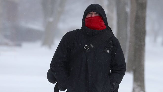 Dan Flincham heading home from work in Rochester on Saturday. Temperatures were from 0 to 5 degrees.