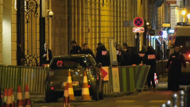 In this image made from video, French police attend the scene outside the Ritz Hotel in Paris, France, after a robbery on Jan. 10.