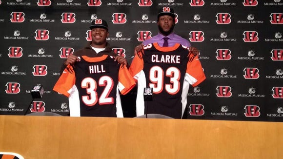 Bengals picks Jeremy Hill and Will Clarke are introduced during a press conference in Cincinnati.